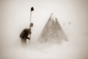 Chris Simmons linking tents with a safety rope during a katabatic wind storm, Otway Massif